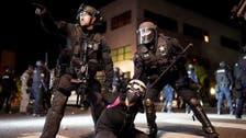 US protests: Portland police declare riot, push demonstrators from building