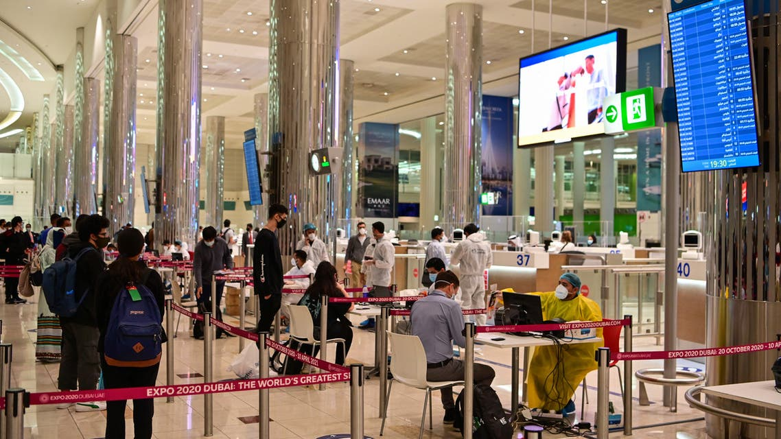 Tourists get a medical screening upon arrival at Teminal 3 at Dubai airport, in the United Arab Emirates, on July 8, 2020. (AFP)