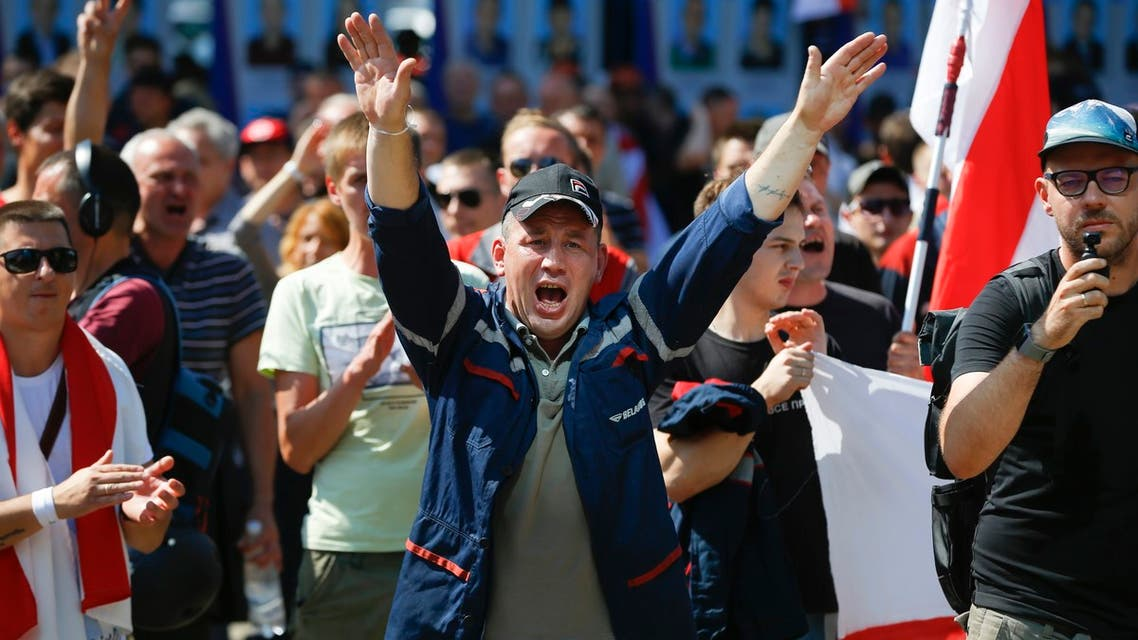 Workers with old Belarus national flags shout anti-Lukashenko slogans during a rally in Minsk, Belarus on Aug. 17, 2020. (AP)