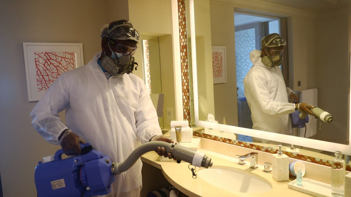 A worker wearing a protective suit sterilises a bathroom in the Atlantis The Palm hotel, as the Emirates reopens to tourism amid the coronavirus disease (COVID-19) outbreak, in Dubai, United Arab Emirates July 7, 2020. REUTERS