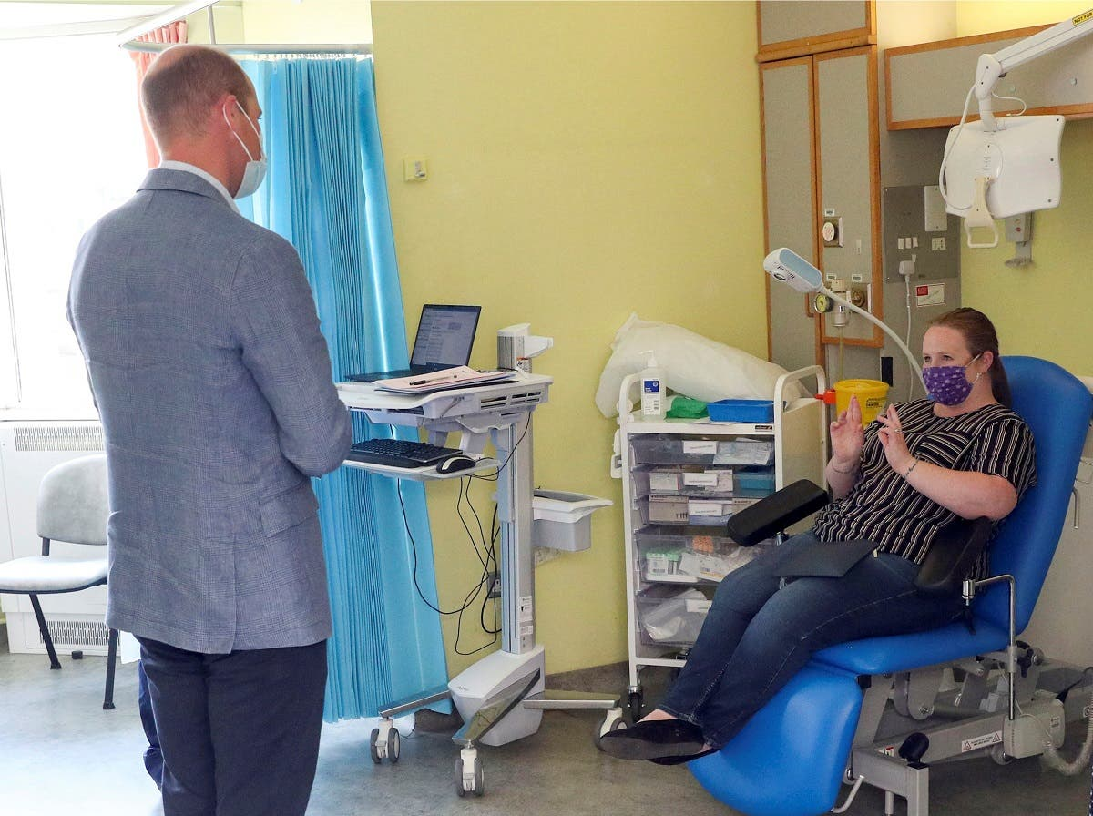 Britain's William, Duke of Cambridge, talks to a patient participating in the COVID-19 vaccine trial at the Oxford Vaccine Group's facility at the Churchill Hospital in Oxford, Britain, June 24, 2020. (Reuters)