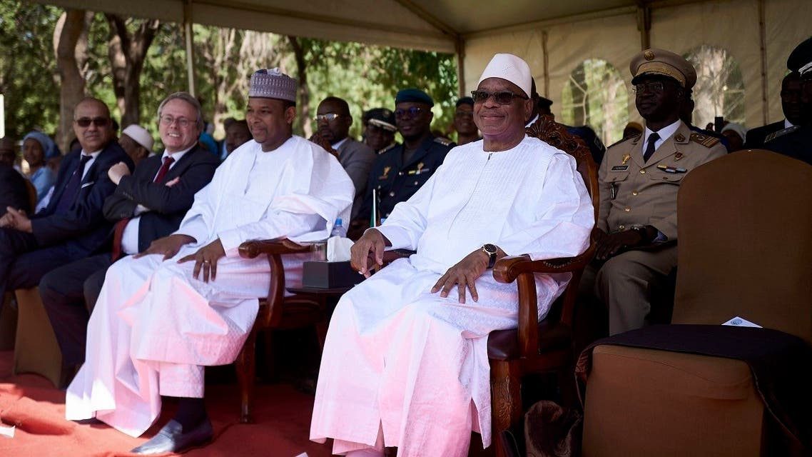 Malian President Ibrahim Boubacar Keita (R) and Malian Prime Minister Boubou Cisse (L) attend the opening of the 12th edition of the Bamako Encounters Photography Biennial. (File photo: AFP)
