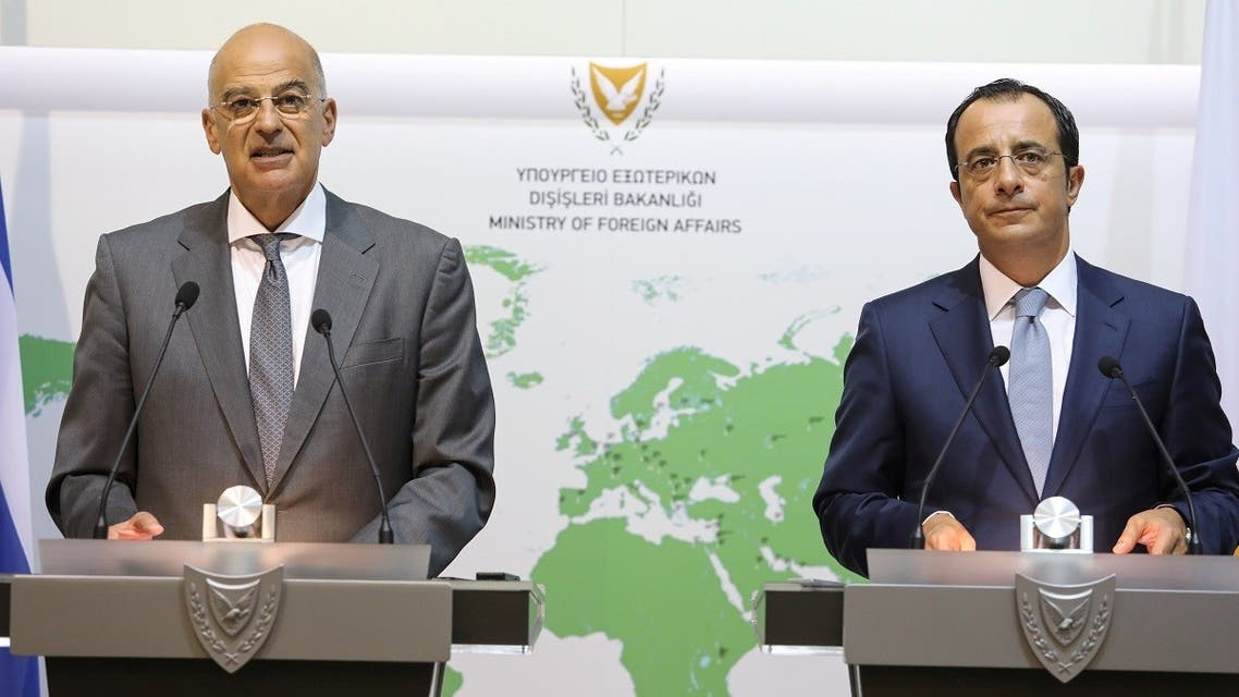Greek FM Nikos Dendias speaks next to Cypriot FM Nikos Christodoulides (R) during a news conference at the Foreign Ministry in Nicosia, Cyprus, August 18, 2020. (Reuters)
