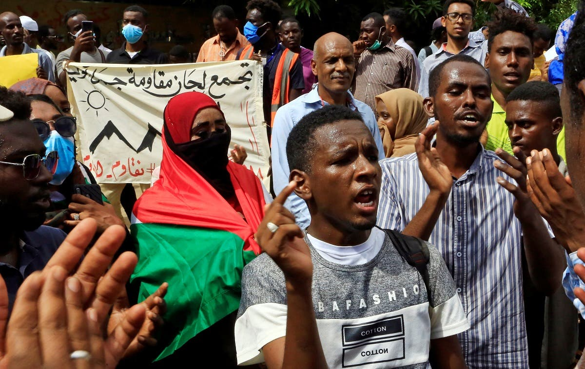 Sudanese protesters march in a demonstration to mark the anniversary of a transitional power-sharing deal in Khartoum, Sudan, on August 17, 2020. (Reuters)