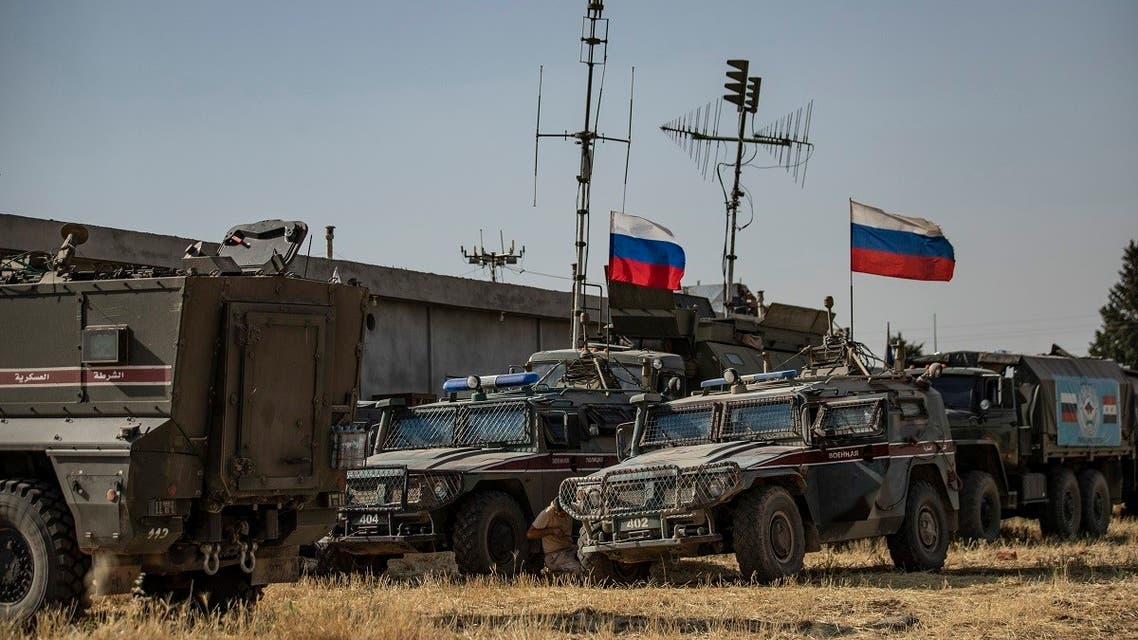 Russian soldiers reposition in the town of Derouna Arha near the Syrian border with Turkey on June 16, 2020. (AFP)