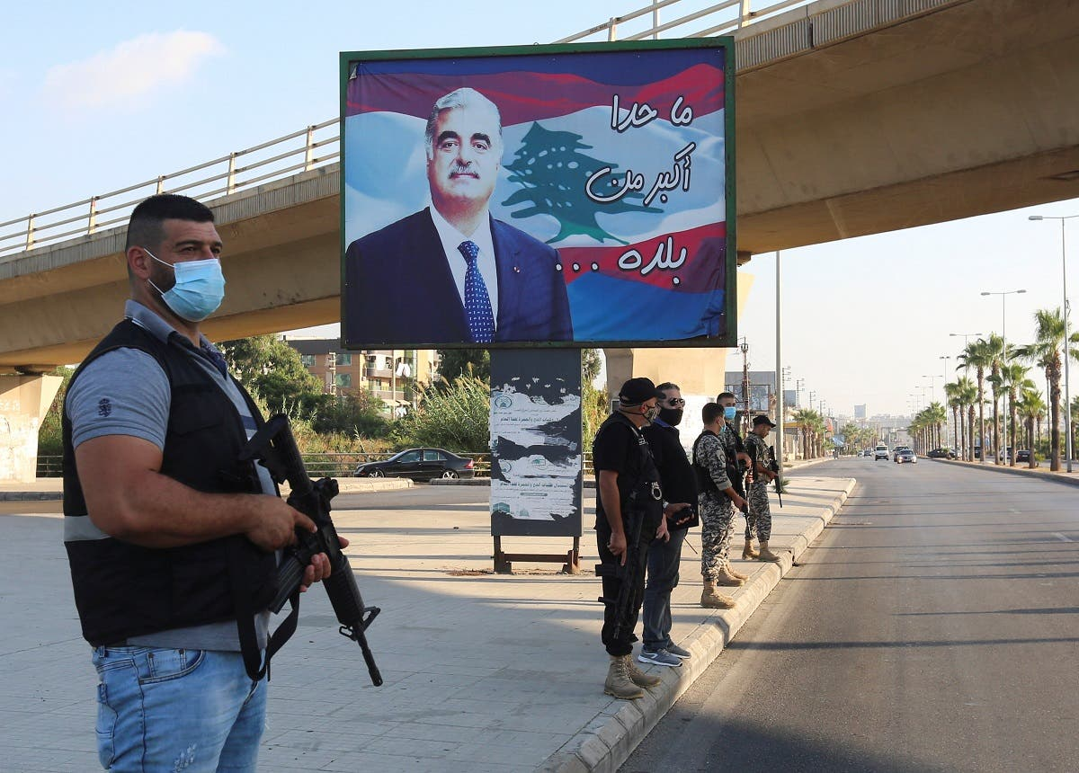 Members of security forces stand guard near a billboard depicting Lebanon's former Prime Minister Rafik al-Hariri, who was killed in a 2005 suicide bombing, in Sidon, southern Lebanon. (File photo: Reuters)