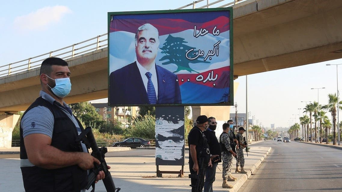 Members of security forces stand guard near a billboard depicting Lebanon's former Prime Minister Rafik al-Hariri, who was killed in a 2005 suicide bombing, in Sidon, southern Lebanon. (Reuters)
