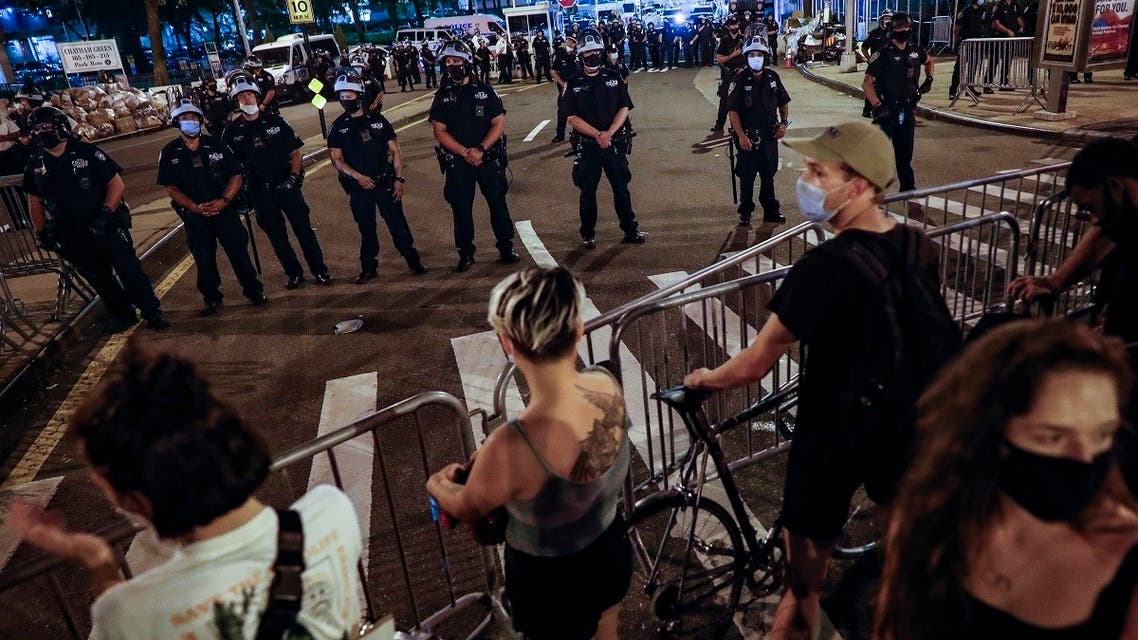 Demonstrators stand at a police barricade as New York City police officers near a protest march in support of the Black Lives Matter movement and other groups, July 30, 2020, in New York. (AP)