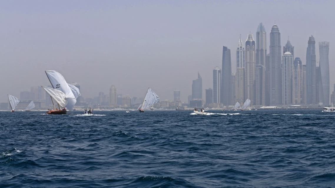 Dhows participate in the al-Gaffal traditional long-distance dhow sailing race near the finish line off of Dubai, on May 14, 2017, after starting from the Gulf island of Sir Bu Nair. (File photo: AFP)