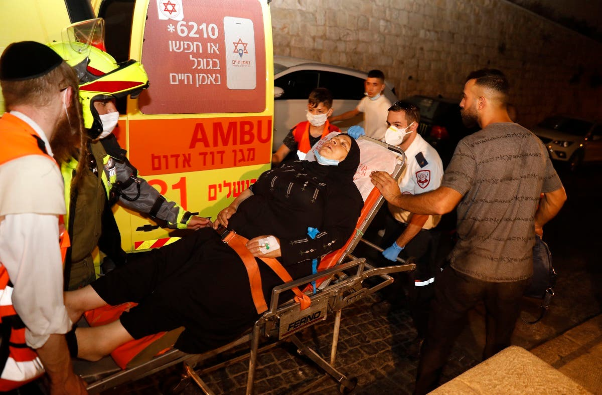A Palestinian woman is carried in a stretcher by Israeli medics in Old City of Jerusalem following a reported stabbing attack, August 17, 2020. (AFP)