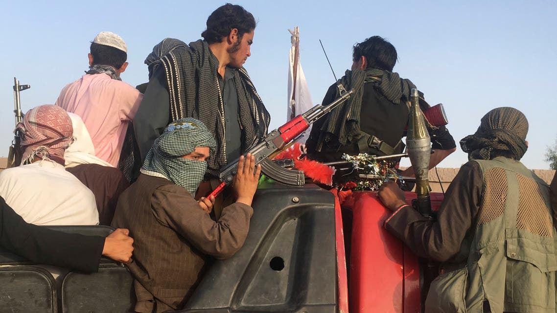 In this June 16, 2018 photo, Taliban fighters ride in their vehicle in Surkhroad district of Nangarhar province, east of Kabul, Afghanistan. (AFP)
