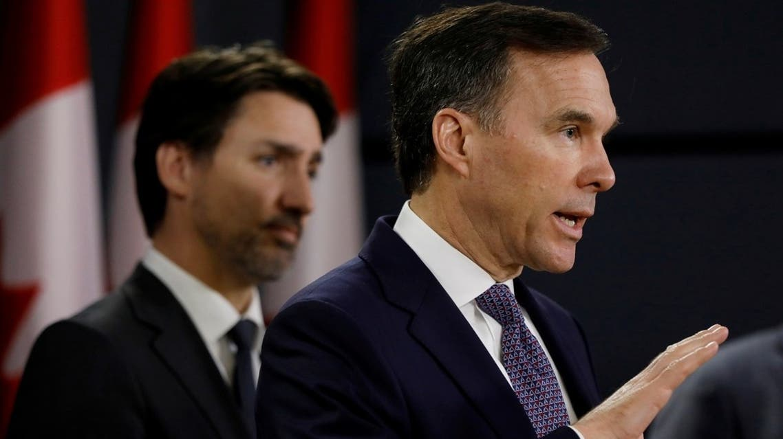 Canada's Minister of Finance Bill Morneau attends a news conference with Prime Minister Justin Trudeau in Ottawa, Ontario, Canada, March 11, 2020. (Reuters)