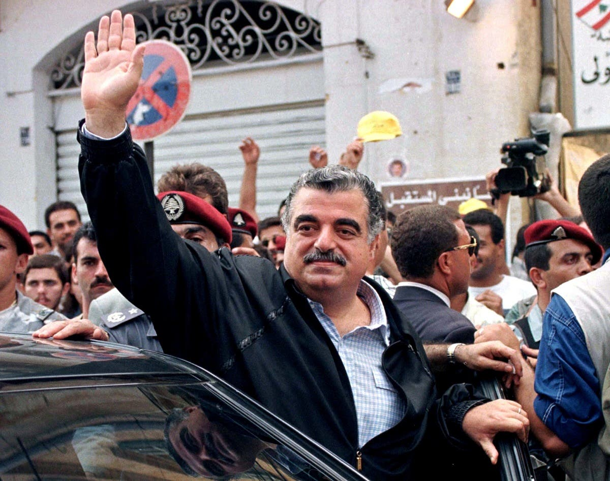 Former Lebanese Prime Minister Rafik Hariri waves to supporters after casting his vote at a Beirut polling station in Lebanon, Sept. 1, 1996. (File Photo: Reuters)