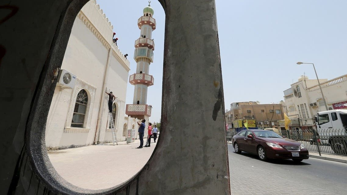 Workers install a security camera outside the Al A'ali Grand Mosque, where joint Sunni and Shi'ites prayers are to be held to show solidarity and co-existence between the two sects of Islam, ahead of Friday prayers in Al A'ali south of Manama, July 3, 2015. (Reuters)