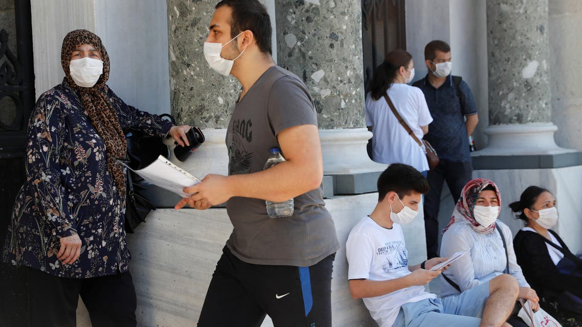 A student wearing a protective face mask arrives at the main campus of the Istanbul University to take the national university entrance exams, amid the spread of the coronavirus disease (COVID-19), in Istanbul, Turkey June 27, 2020. REUTERS/Murad Sezer
