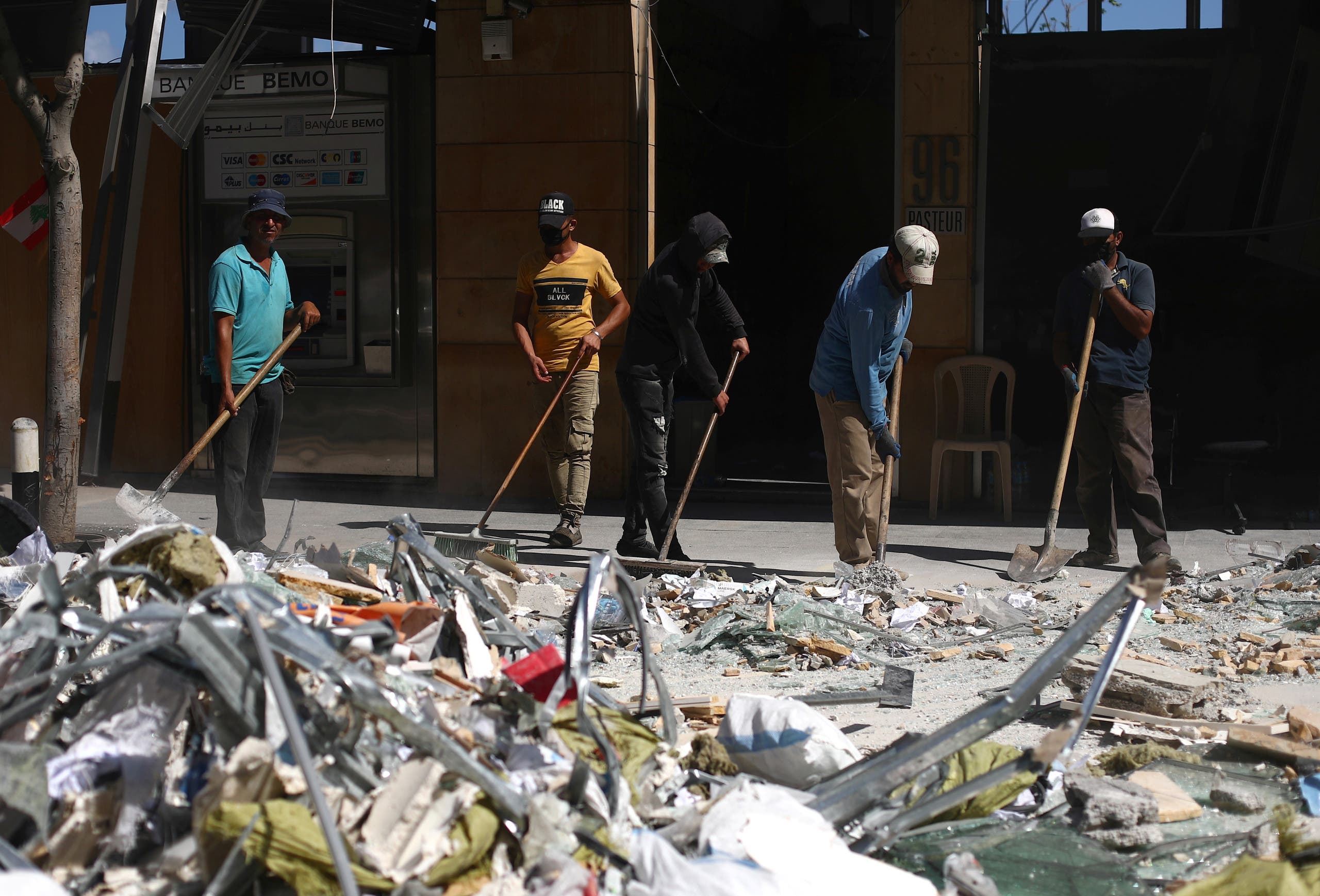 People clean debris from the street following Tuesday's blast in Beirut's port area, Lebanon August 9, 2020. (Reuters)