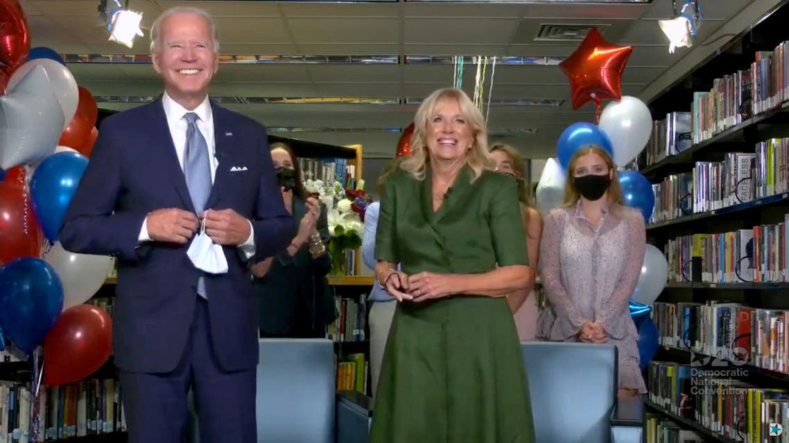 Joe Biden, accompanied by his wife Jill Biden, celebrates after being formally nominated as 2020 U.S. democratic presidential candidate in convention roll call during the virtual 2020 Democratic National Convention. (Reuters)