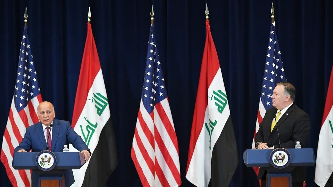 Iraq's Foreign Minister Fuad Hussein (L) speaks during a press conference with US Secretary of State Michael Pompeo at the State Department, Aug. 19, 2020. (AFP)