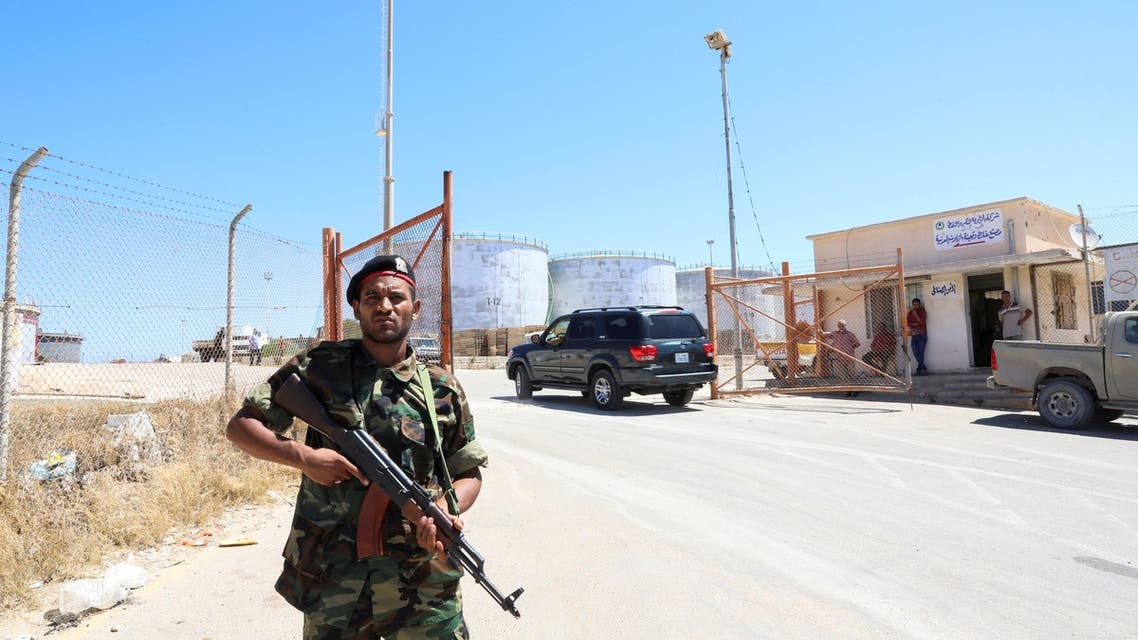 A member of the Petroleum Facilities Guard is seen at the entrance of Azzawiyah Oil Refinery, in Zawiyah west of Tripoli, Libya July 23, 2020. REUTERS/Ismail Zitouny