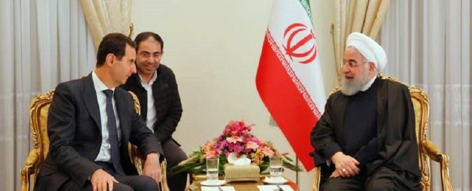 محمد القصير، في صورة نادرة بين الرئيسين الايراني حسن روحاني والسوري بشار الأسد، العام الماضي بطهران
