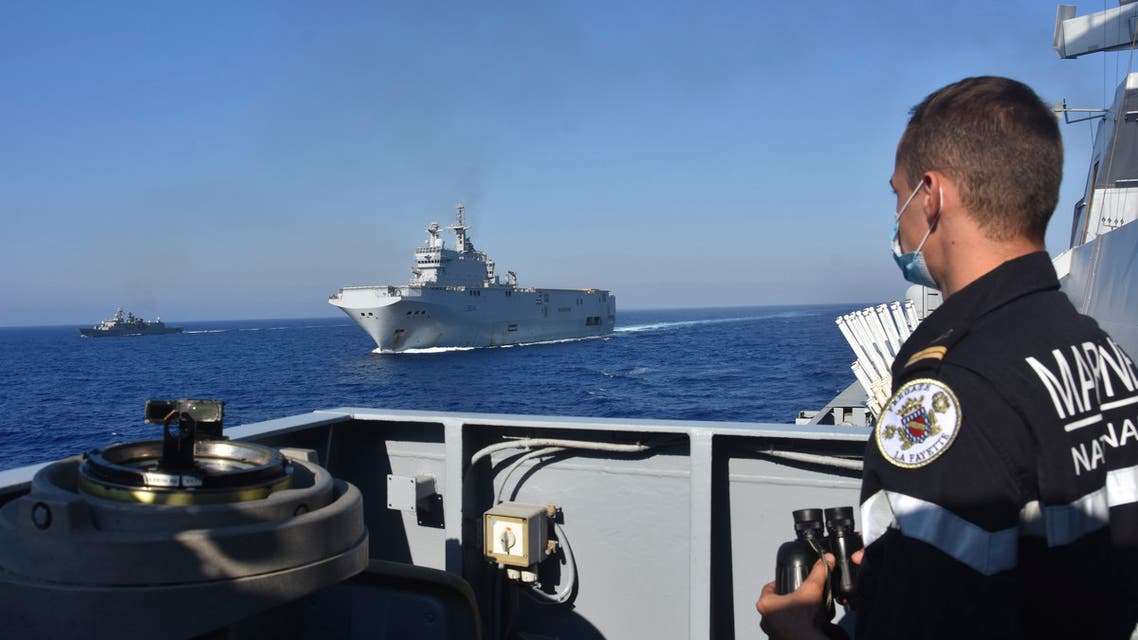 The French Tonnerre helicopter carrier, center, escorted by Greek and French military vessels during a maritime exercise in the Eastern Mediterranean, Thursday, Aug. 13, 2020. (AP)