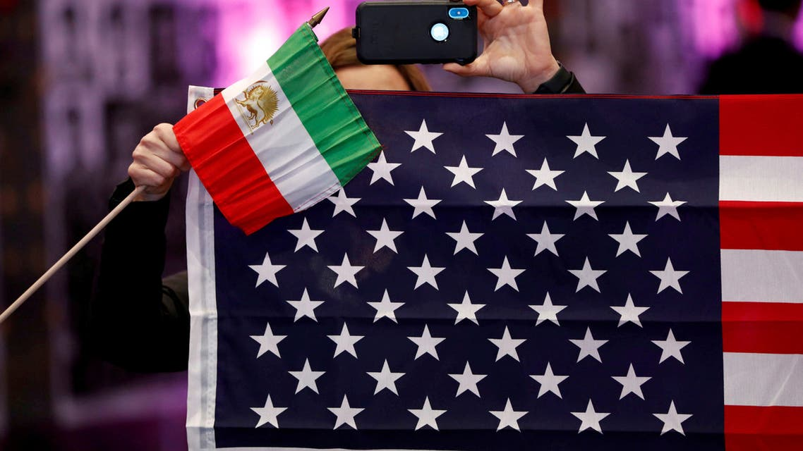 Attendees hold flags from Iran and the United States as Iranian Americans from across California converge in Los Angeles to participate in the California Convention for a Free Iran and to express support for nationwide protests in Iran from Los Angeles, California, U.S., January 11, 2020. (Reuters)