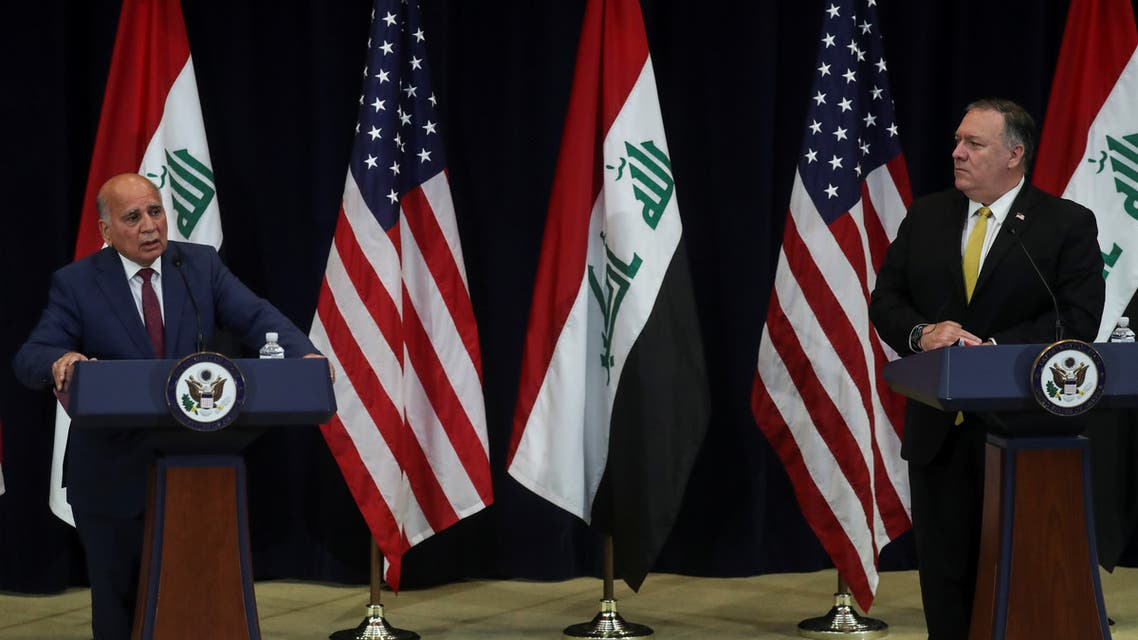 US Secretary of State Mike Pompeo looks to Iraq's Foreign Minister Fuad Hussein face reporters at the State Department in Washington, US, August 19, 2020. (Reuters)