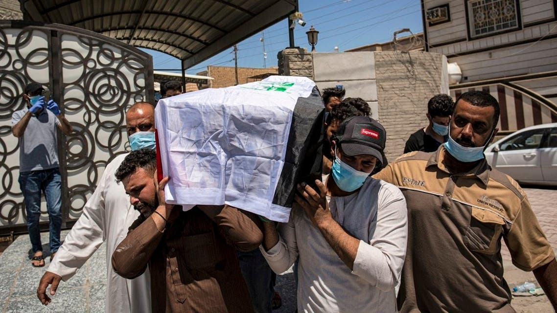 Mourners carry the Iraqi-flag draped coffin of slain activist Dr. Riham Yacoub Iraq's southern city of Basra, Aug. 20, 2020. (AFP)