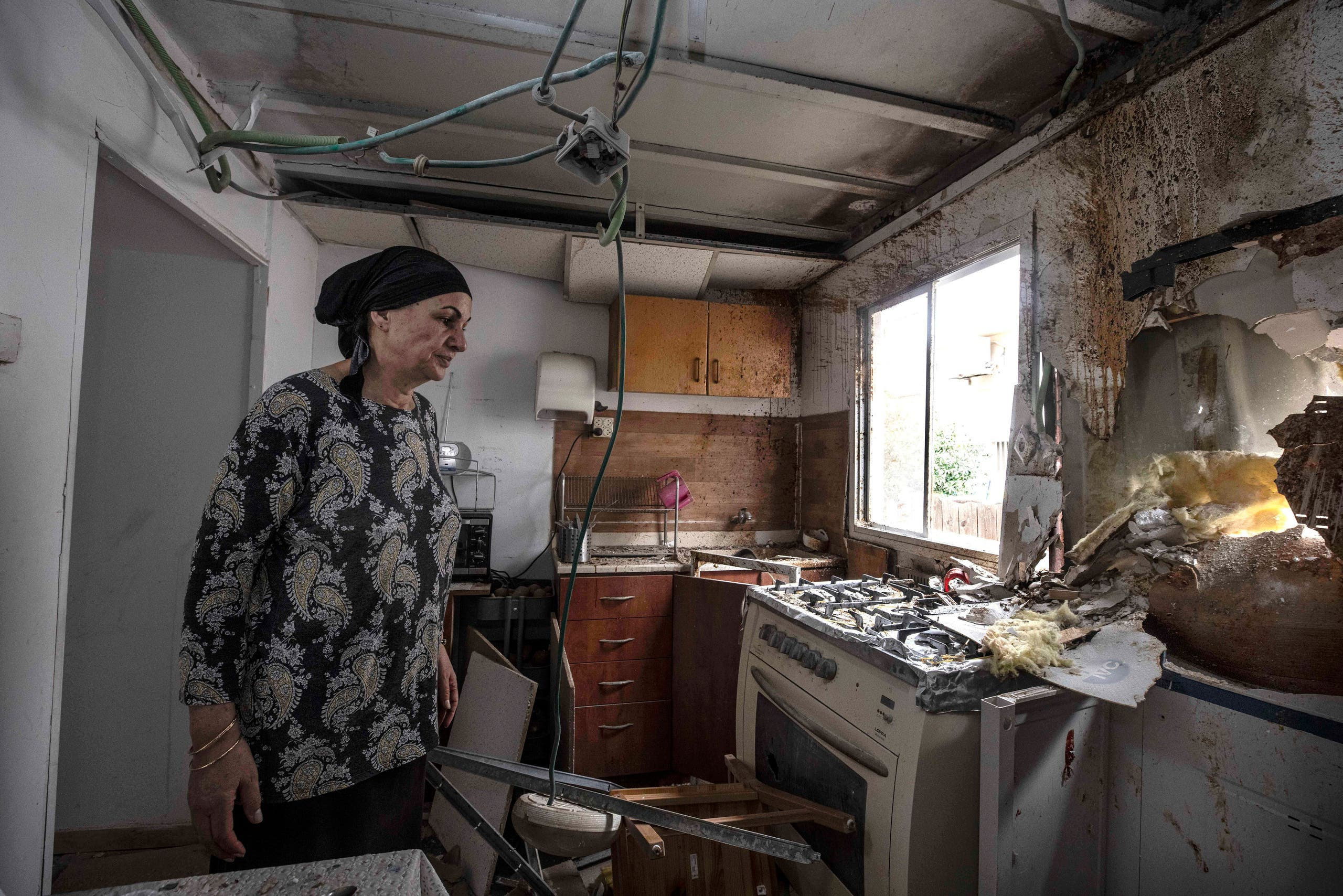 Homeowner Osnat Malka inspects damage from a rocket fired overnight by Palestinian militants from the Gaza Strip, in Sderot, Israel, Friday, Aug. 21, 2020. (AP)