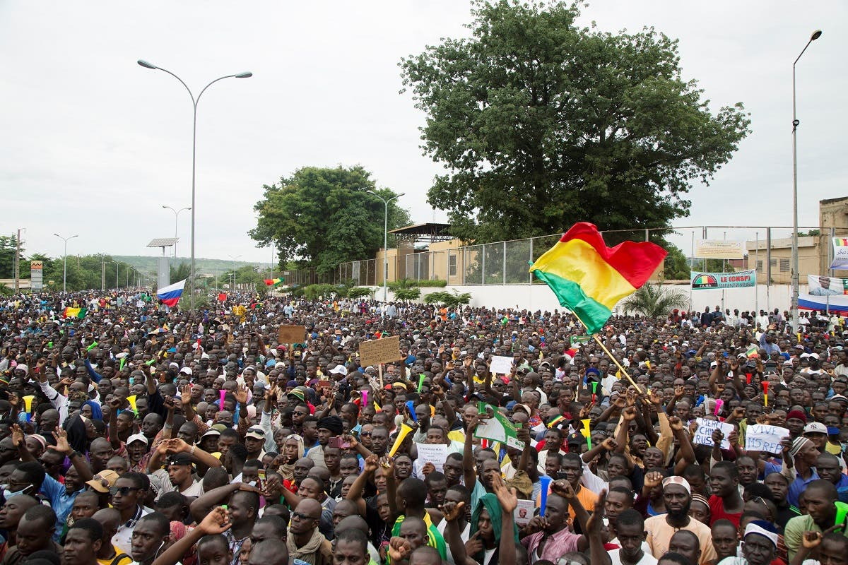 Demonstrators gather during a protest to support the Malian army and the National Committee for the Salvation of the People (CNSP) in Bamako, Mali, on August 21, 2020. (AFP)