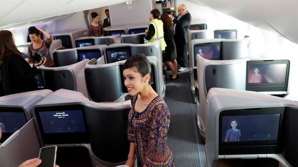 2018-03-28T1A stewardess with Singapore Airlines talks with media during a presentation of the interior of the airline's Boeing 787-10 Dreamliner after a delivery ceremony at the Boeing South Carolina plant in North Charleston, South Carolina, US. (Reuters)11631Z_461493684_RC1767619970_RTRMADP_3_BOEING-787