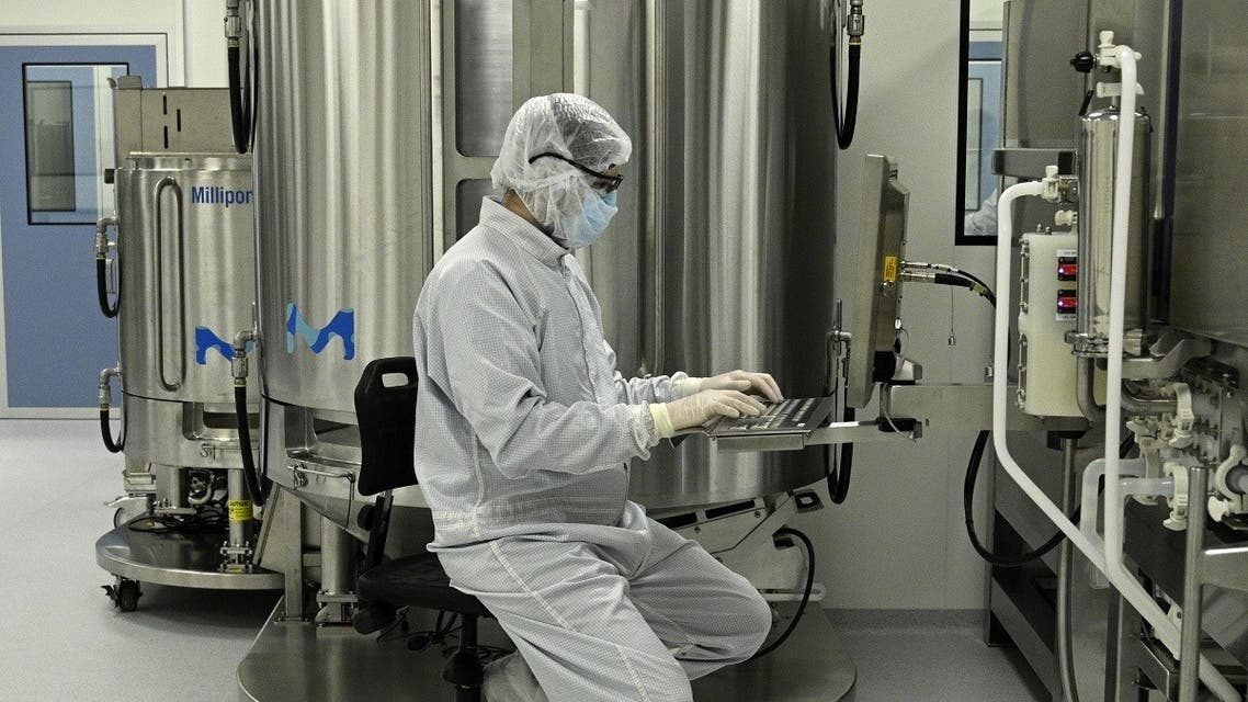 A scientist works at the mAbxience biosimilar monoclonal antibody laboratory plant in Garin, Buenos Aires province, on August 14, 2020, where an experimental coronavirus vaccine will be produced for Latin America. (AFP)