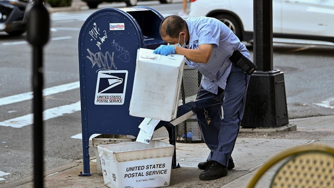 A United States Postal Service worker makes his rounds in Manhattan, Aug. 20, 2020. (AFP)