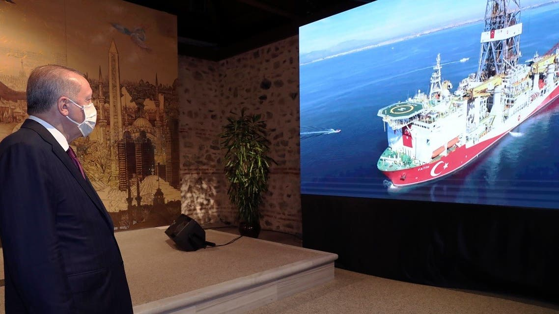 Turkey's President Recep Tayyip Erdogan watches Turkish drilling ship, Fatih, in the background, as he speaks in Istanbul, August 21, 2020. (AP)