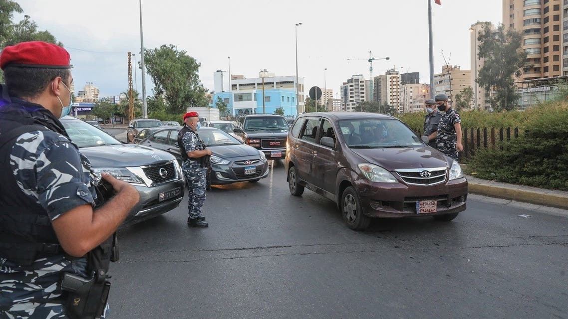 Members of the Lebanese security forces man a checkpoint on an avenue in the capital Beirut to verify the compliance with restrictions on the first day of a reinstated lockdown to combat a surge in COVID-19 cases, on August 21, 2020. (AFP)