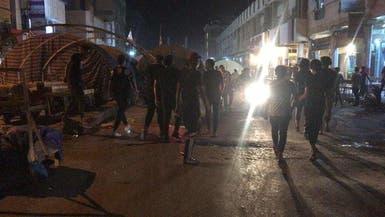 غضب بالعراق.. حرق صور المالكي ومقرات الأحزاب بالناصرية