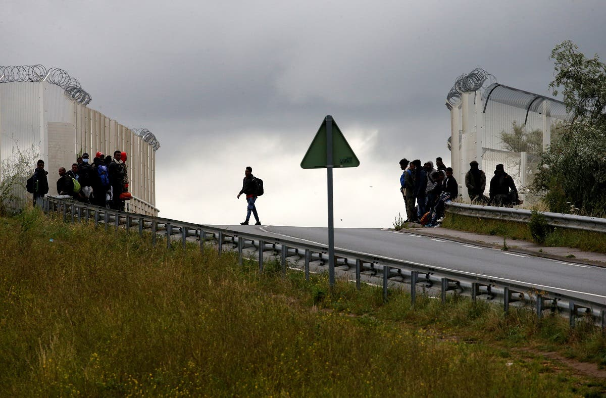 Migrants leave as French police officers dismantle a makeshift shelter camp in Calais, France, on July 10, 2020. (Reuters)