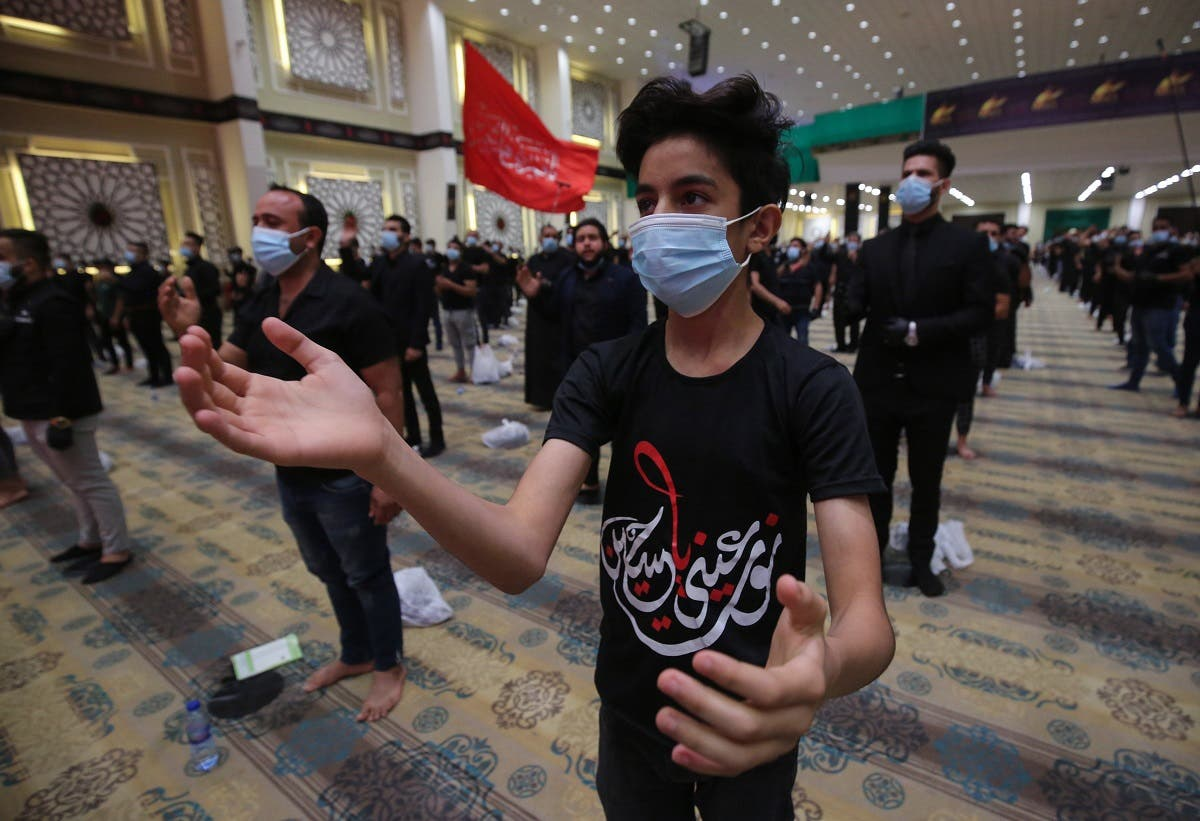 An Iraqi youth beats his chest in a mourning ritual as Shiite Muslim men mark Ashura commemorations at the headquarters of Shiite Muslim leader and head of Hikma party Ammar al-Hakim, in the capital Baghdad, on August 21, 2020. (AFP)