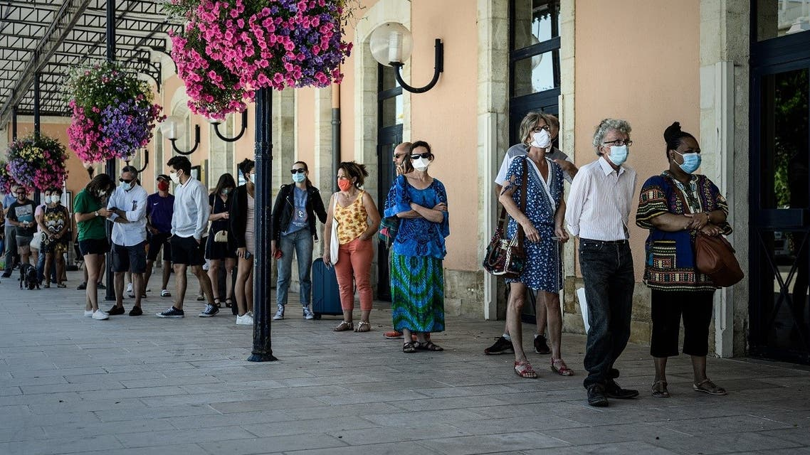People queue at a coronavirus free screening operation outside the Arcachon railway station, southwestern France, on July 24, 2020. (AFP)