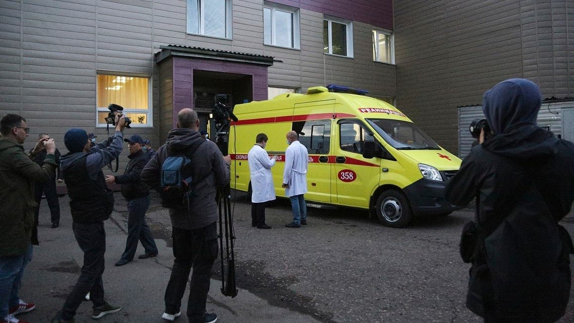 An ambulance is parked at the Omsk Ambulance Hospital No. 1 to pick up Alexei Navalny to the airport in Omsk, Russia, Saturday, Aug. 22, 2020.