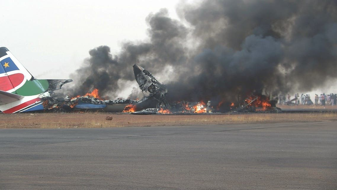 A file photo made available by UNMISS, united Nations Mission South Sudan, on March 20, 2017 shows a plane in flames after it crashed along the runway at Wau Airport, northern South Sudan. (AFP)