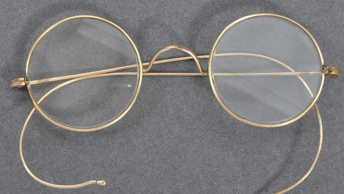 a pair of glasses that once belonged to Indian independence icon Mahatma Gandhi. (AFP)