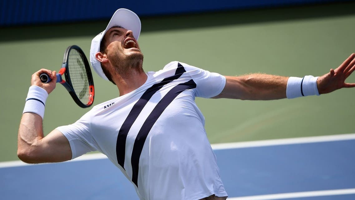 Andy Murray serves the ball against Frances Tiafoe during the Western & Southern Open at the USTA Billie Jean King National Tennis Center. Mandatory Credit: Robert Deutsch-USA TODAY Sports
