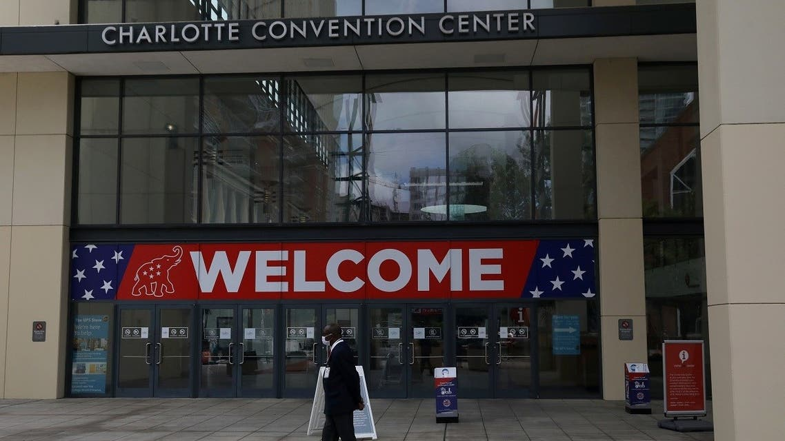 A person walks outside the Charlotte Convention Center, the site of the Republican National Convention, in Charlotte, North Carolina, U.S., August 22, 2020. REUTERS