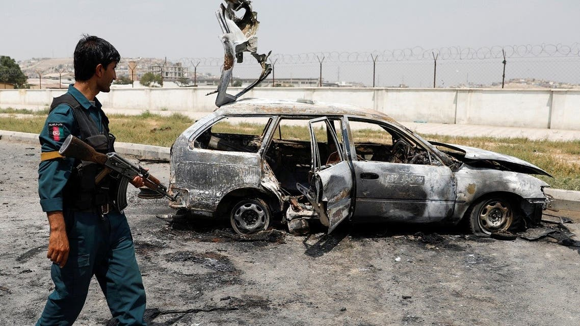 An Afghan police officer inspects a vehicle from which insurgents fired rockets, in Kabul, Afghanistan. (Reuters)