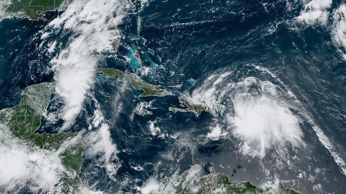 Image obtained from the National Oceanic and Atmospheric Administration (NOAA) shows Tropical Storm Laura over Puerto Rico and approaching Haiti. (AFP)