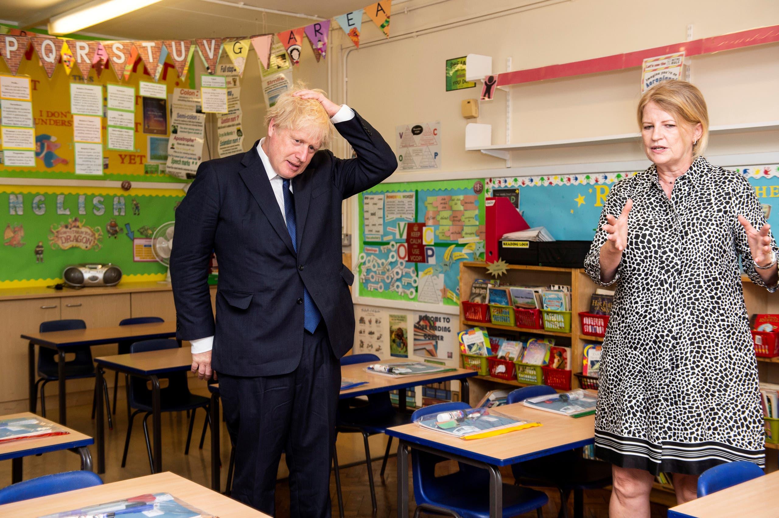 جونسون يزور إحدى مدارس لندن للاطلاع على إجراءات الوقاية من كورونا