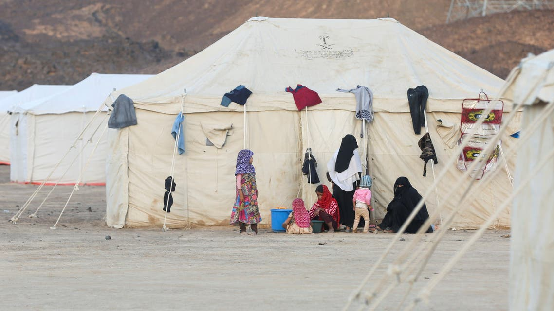 Women and children are pictured at a camp for people recently displaced by fighting in Yemen's northern province of al-Jawf between government forces and Houthis, in Marib, Yemen March 8, 2020. Picture taken March 8, 2020. REUTERS/Ali Owidha
