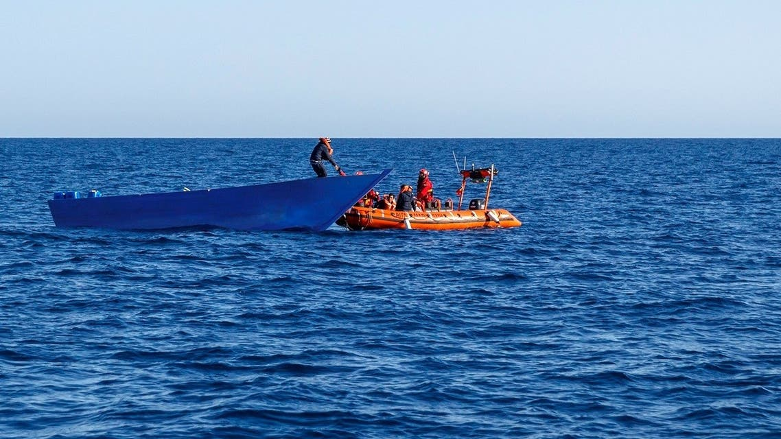 A file photo shows members of the Spanish NGO Maydayterraneo rescue a migrant in Mediterranean international waters off the Libyan coast on February 10, 2020. (AFP)