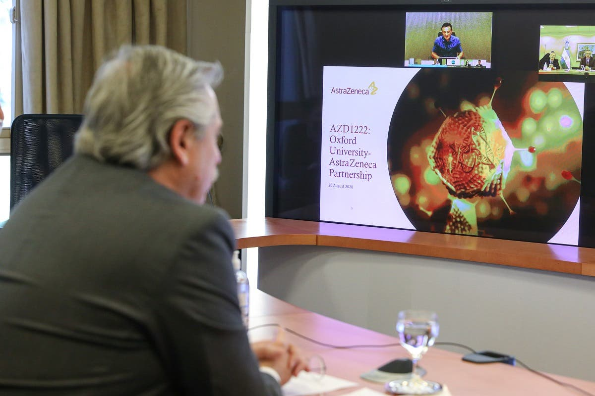 Argentina's President Alberto Fernandez attends a video conference with AstraZeneca's Chief Executive Officer Pascal Soriot, at the Olivos Presidential Residence, in Buenos Aires. (Reuters)